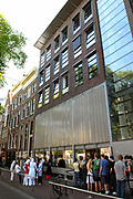The Anne Frank House on the Prinsengracht in Amsterdam, The Netherlands, is a museum dedicated to Jewish wartime diarist Anne Frank, who hid from Nazi persecution with her family and four other people in hidden rooms at the rear of the building. As well as the preservation of the hiding place — known in Dutch as the Achterhuis —and an exhibition on the life and times of Anne Frank, the museum acts as an exhibition space to highlight all forms of persecution and discrimination.<br /> <br /> It opened on May 3, 1960 with the aid of public subscription, three years after a foundation was established to protect the property from developers who wanted to demolish the block.