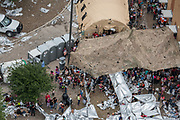 Migrants are crowded into an area outside the U.S. Border Patrol McAllen Station in a makeshift encampment after the inside of the facility was filled to capacity in McAllen, Texas, U.S., May 15, 2019.