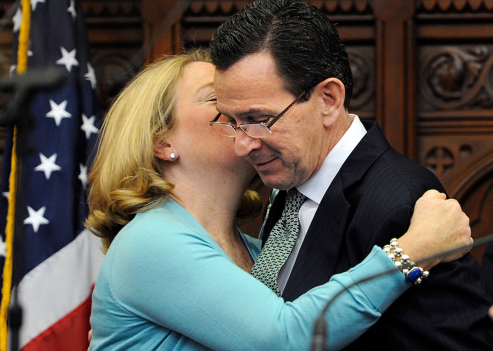Connecticut Gov. Dannel P. Malloy receives a hug and kiss from his wife Cathy Malloy, left, after outlining his budget proposals for the next fiscal year during a noon joint session of the General Assembly at the Capitol in Hartford, Conn., Wednesday, Feb. 6, 2013. Malloy unveiled the second, two-year budget of his administration on Wednesday, promising to move Connecticut closer to recovery from the national recession by continuing investments in education and job development. (AP Photo/Jessica Hill)