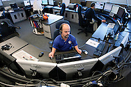 Chris Kotzian works his desk as a dispatcher for the city of Lakewood police department in Lakewood, Colorado March 31, 2010.  At about four-feet-tall,  Chris is a achondroplasia dwarf with a rare genetic disorder of bone growth.  Preferring to be called a little person he is active in the Little People of America, the only dwarfism support organization that includes all 200+ forms of dwarfism.  REUTERS/Rick Wilking (UNITED STATES)