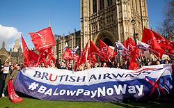 © Licensed to London News Pictures. 07/02/2017. London, UK. Striking cabin crew working for British Airways' mixed fleet demonstrate with flags and placards outside parliament today, seeking MPs' support for a higher wage. Photo credit : Tom Nicholson/LNP