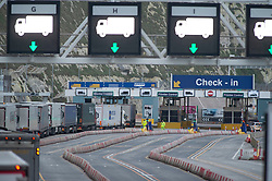 © Licensed to London News Pictures 26/12/2020.        Dover, UK. Lorries checking in at the Port of Dover. Over 1000 lorries are left queuing on the M20 heading for Dover as Manston Airport is cleared. Emergency services and military personnel continue to tests travellers at Dover in Kent for Coronavirus before they cross the English Channel. Photo credit:Grant Falvey/LNP