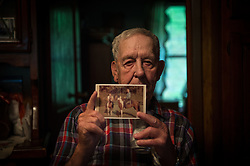 Hershel Aleshire of Blair, West Virginia which is in the heart of the Appalachian mountains, sits inside his home. He is in the heart of America where mountaintop-removal mines are abundant. Mountaintop Removal is a method of surface mining that literally removes the tops of mountains to get to the coal seams beneath. It is the most profitable mining technique available because it is performed quickly, cheaply and comes with hefty economic benefits for the mining companies, most of which are located out of state. Many argue that they have brought wage-paying jobs and modern amenities to Appalachia, but others say they have only demolished an estimated 1.4 million acres of forested hills, buried an estimated 2,000 miles of streams, poisoned drinking water, and wiped whole towns from the map. The mountaintop-removal mine near Blair caused the population to fall from 700 in the 1990s to fewer than 50 today, according to the Blair Mountain Heritage Alliance. © Ami Vitale