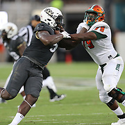 ORLANDO, FL - AUGUST 29: Randy Charlton #5 of the UCF Knights and Tarique Akbar #79 of the Florida A&M Rattlers battle during a NCAA football game on August 29 2019 in Orlando, Florida. (Photo by Alex Menendez/Getty Images) *** Local Caption *** Randy Charlton; Tarique Akbar