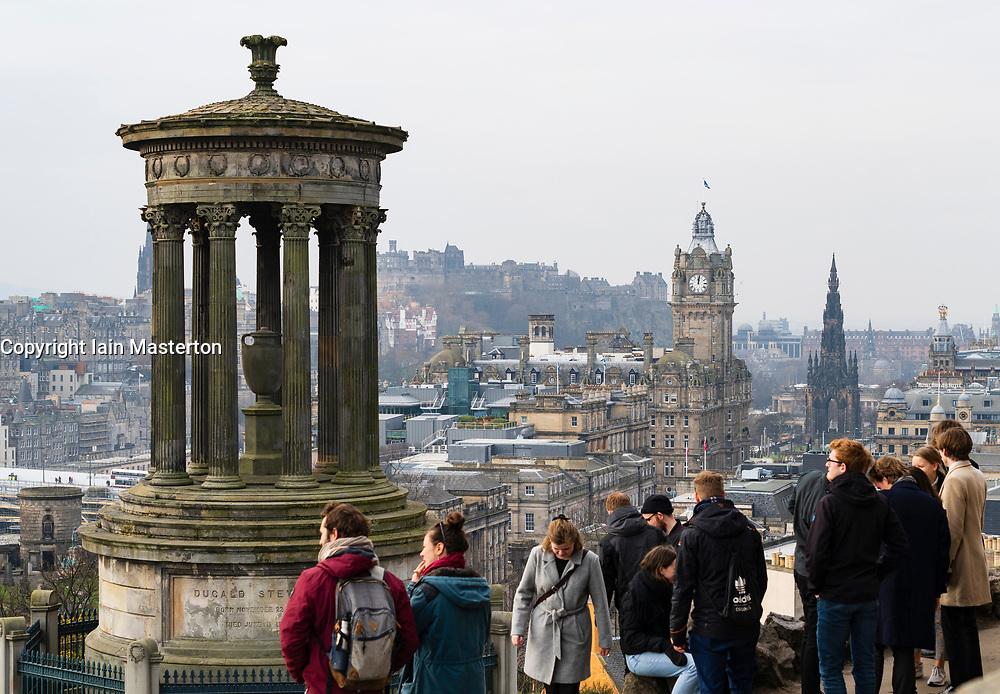 Tourists enjoying view of city of Edinburgh from Calton Hill viewpoint, Scotland, UK