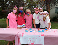 Merrick, New York, U.S. August 15, 2020. Tweens, L-R, MARIA, KATIE, REESE, ISABELLE, MADDY, and ANNIE FITZPATRICK, all wearing face masks, are selling shells they painted, to raise funds Lizzie's Army plans to donate to American Cancer Society Making Strides Against Breast Cancer.  When Annie's 24-year-old sister Lizzie Fitzpatrick was diagnosed with Triple Negative Breast Cancer in late June, Annie, Maddy and Isabelle formed Lizzie's Army. Over $3,000 has been raised so far through shell sales and GoFundMe.