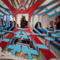 """050915       Cable Hoover<br /> <br /> A crowd of gallery patrons is reflected in the mirrored sections of a piece called """"Hall of Mirrors"""" by artist Thomas Tomlinson at Art123 Gallery during ArtsCrawl in downtown Gallup Saturday."""