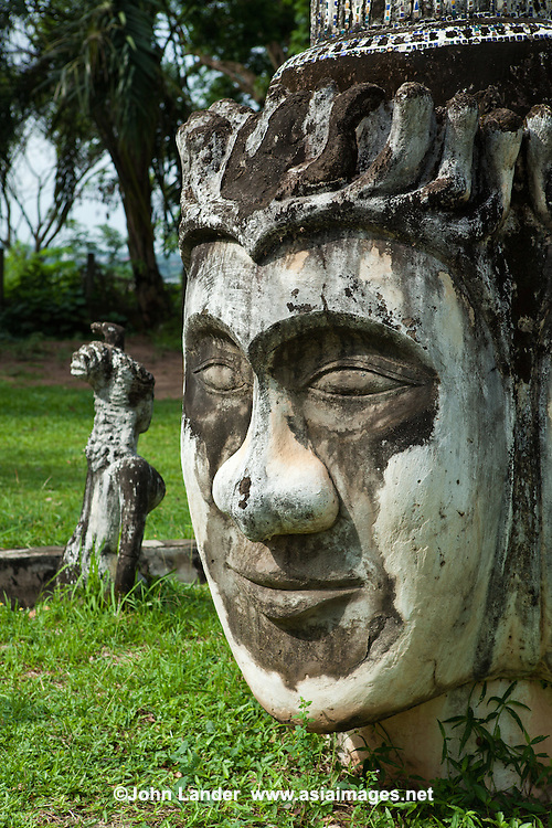 """One of the quirkiest, yet most interesting attractions in Vientiane would have to be Xieng Khuan, commonly called """"Buddha Park"""". Xieng Khuan or """"Spirit City"""" is just as much a monument to one man's eccentric and bizarre ambition as it is an impressive collection of massive ferro-concrete sculptures dotted around a riverside meadow. Although the brontosaurian reclining Buddha and strange edifice resembling a pumpkin - there are statues of every conceivable deity in the Buddhist/Hindu pantheon. Even if you are not up on your Buddhist/Hindu deities you will enjoy strolling around some of the more fantastic shapes.  Xieng Khuan was designed and built in 1958 by Louang Pou Bunleua Sulilat a self style holy man who took Hinduism and Buddhism and merged them into his own iconography. After the revolution in 1975, he fled from Laos to Thailand where he built another sculpture park, Sala Keoku in Nong Khai.. He fled because his anti-Communist beliefs conflicted with the views of the Pathet Lao."""