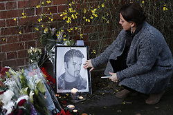 © Licensed to London News Pictures. 26/12/2016. Goring-, UK. Floral tributes are left at the door of George Michael's Oxfordshire home. Pop superstar George Michael died on Christmas day at his Oxfordshire home on the River Thames aged 53. Photo credit: Peter Macdiarmid/LNP