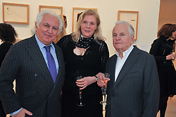 Left to right, TONY SHAFRAZI, SOPHIE DE STEMPEL and IAN HOLM at a private view of work by Brian Clarke - Works on Paper 1969-2011 held in the Phillips de Pury Galleries, The Saatchi Gallery, London on 28th February 2011.