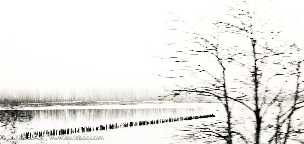 B&W photograph of the Columbia River in the Columbia Gorge on a winter day.