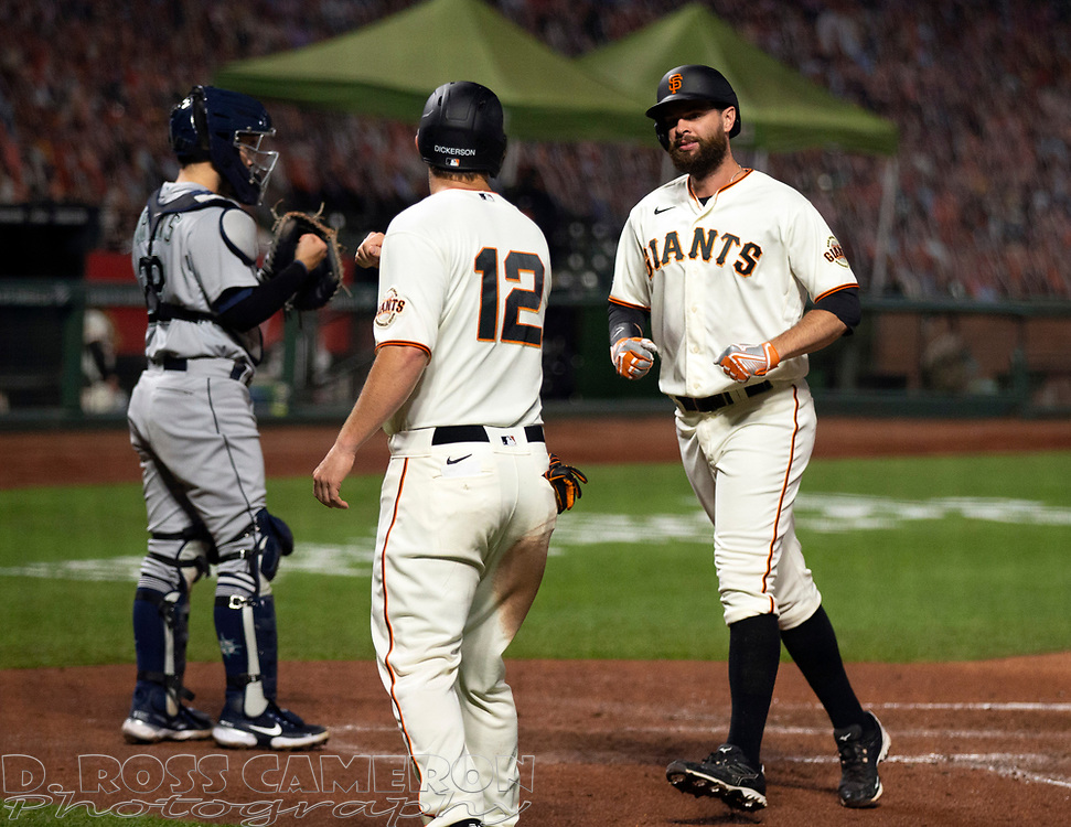 Sep 16, 2020; San Francisco, CA, USA; San Francisco Giants first baseman Brandon Belt, right, celebrates with teammate Alex Dickerson (12) after hitting a two-run home run against the Seattle Mariners during the third inning of a baseball game at Oracle Park. Mandatory Credit: D. Ross Cameron-USA TODAY Sports