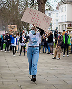 """A women leading the chants """"Kill the Bill"""" against the newly introduced restritions to the right to protest. Cheltenham, 20/03/2021"""