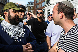 London, UK. 10th June, 2018. Pro-Palestinian and pro-Israel activists debate in the street before the pro-Palestinian Al Quds Day march through central London organised by the Islamic Human Rights Commission. An international event, it began in Iran in 1979. Quds is the Arabic name for Jerusalem.
