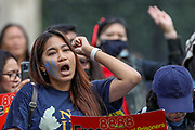 """Members of the Burmese community are seen shouting anti-military slogans and some of them gesturing three fingers outside Westminster Palace, Houses of Parliament in central London on Sunday, Aug 8, 2021 - during a global campaign """"SAVE Myanmar"""" to mark 33 years of the 8888 uprising and struggles for democracy against military rule in the country. (VX Photo/ Vudi Xhymshiti)"""
