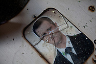A smashed photograph of the Syrian president Bashar al-Assad in the village of Kathrine in Idlib province, now deserted. The residents left after the Free Syrian Army gained control of the surrounding villages. According to locals the village was pro-regime and from the Alawite sect, the same as the president bashar al-Assad. 19/11/2012