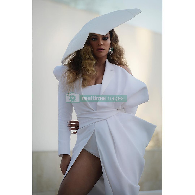 """Beyonce releases a photo on Instagram with the following caption: """""""". Photo Credit: Instagram *** No USA Distribution *** For Editorial Use Only *** Not to be Published in Books or Photo Books ***  Please note: Fees charged by the agency are for the agency's services only, and do not, nor are they intended to, convey to the user any ownership of Copyright or License in the material. The agency does not claim any ownership including but not limited to Copyright or License in the attached material. By publishing this material you expressly agree to indemnify and to hold the agency and its directors, shareholders and employees harmless from any loss, claims, damages, demands, expenses (including legal fees), or any causes of action or allegation against the agency arising out of or connected in any way with publication of the material."""