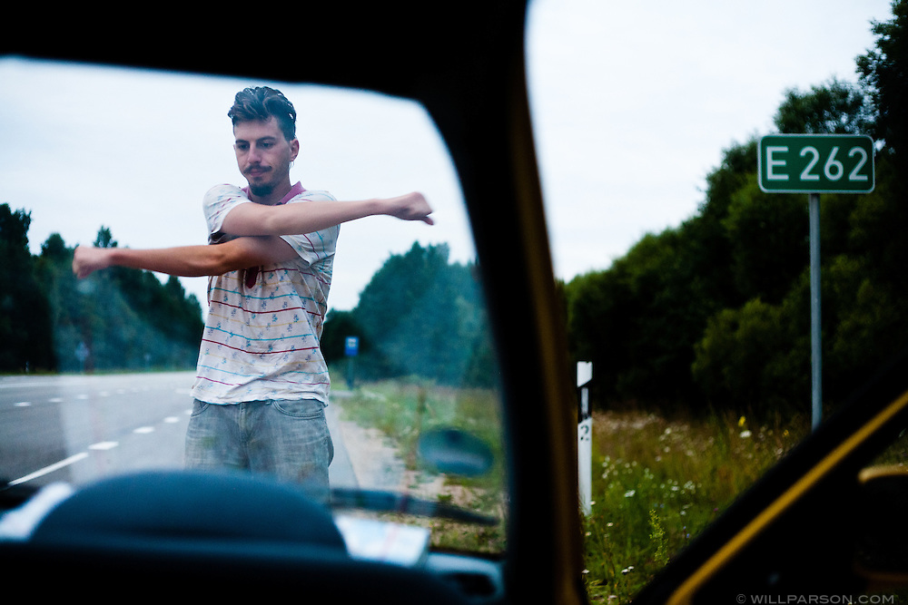 Ryan finishes a driving shift in Latvia, two weeks after the official start of the 2009 Mongol Rally.