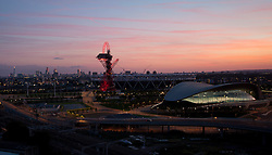 © Licensed to London News Pictures. 19/06/2014. London, UK. A sunset view of the ArcelorMittal Orbit an the London Aquatics Centre from Stratford, east London, the last day before the Summer solstice. Photo credit : Isabel Infantes / LNP