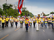 05 MAY 2104 - BANGKOK, THAILAND: Anti-government protestors march down Sanam Chai Road past the Grand Palace in Bangkok. Thousands of Thais packed the area around Sanam Luang and the Grand Palace Monday evening for a special ceremony to mark Coronation Day, which honored the 64th anniversary of the coronation of Bhumibol Adulyadej, the King of Thailand. Many of the people also support the anti-government movement led by Suthep Thaugsuban. Most of the anti-government protesters are conservative supporters of the monarchy.    PHOTO BY JACK KURTZ