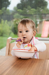 Baby girl portrait table bowl eating happy