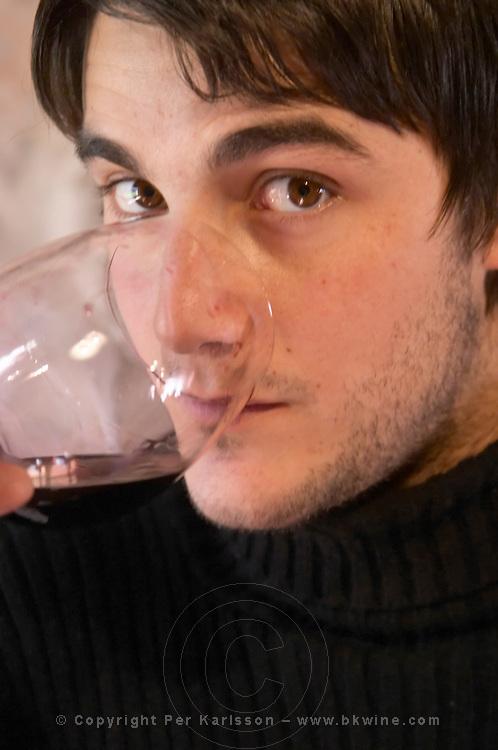 Gabriel Pisano, son of Eduardo Pisano. tasting a glass of wine. Bodega Pisano Winery, Progreso, Uruguay, South America
