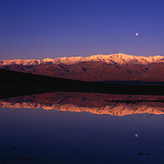 Full moon reflecting in Badwater above Telescope Peak in Death Valley National Park, CA.