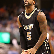 University of Central Florida guard Marcus Jordan (5) dribbles the ball  while taking on the Florida Gators at the Amway Center on December 1, 2010 in Orlando, Florida. Central Florida won the game 57-54 for their first ever victory against a nationally ranked team. (AP Photo/Alex Menendez)