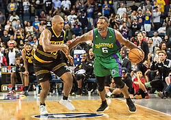 July 6, 2018 - Oakland, CA, U.S. - OAKLAND, CA - JULY 06:Qyntel Woods (6) of 3 Headed Monsters moves around Metta World Peace (15) co-captain of the Killer 3s during game 4 in week three of the BIG3 3-on-3 basketball league on Friday, July 6, 2018 at the Oracle Arena in Oakland, CA  (Photo by Douglas Stringer/Icon Sportswire) (Credit Image: © Douglas Stringer/Icon SMI via ZUMA Press)