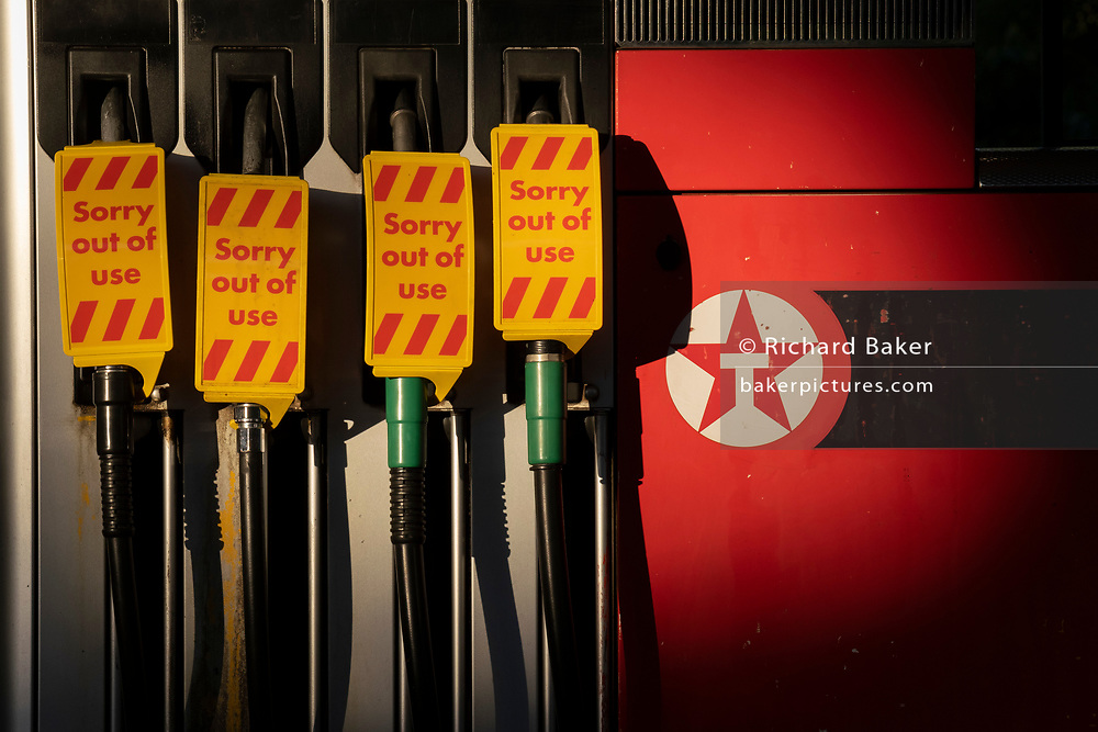As the fuel transport crisis continues into its second week, sealed Texaco petrol and diesel pumps are covered in a closed petrol and fuel station in south London, on 27th September 2021, in London, England. The shortages at retailers around the country are caused by the UK's lack of qualified HGV (Heavy Goods Vehicles) drivers who deliver supplies to the nation's fuel forecourts, the majority of which are now closed after panic-buying drained fuel stock.