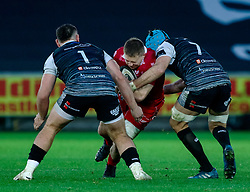 James Davies of Scarlets under pressure from Justin Tipuric of Ospreys<br /> <br /> Photographer Simon King/Replay Images<br /> <br /> Guinness PRO14 Round 11 - Ospreys v Scarlets - Saturday 22nd December 2018 - Liberty Stadium - Swansea<br /> <br /> World Copyright © Replay Images . All rights reserved. info@replayimages.co.uk - http://replayimages.co.uk
