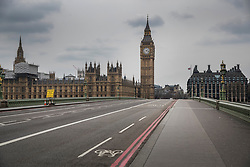© Licensed to London News Pictures.23/03/2017.London, UK. For a brief second Westminster Bridge is completely empty as it opened for the first time on the day after a lone terrorist killed 4 people and injured several more, in an attack using a car and a knife. The attacker managed to gain entry to the grounds of the Houses of Parliament, killing one police officer.Photo credit: Peter Macdiarmid/LNP