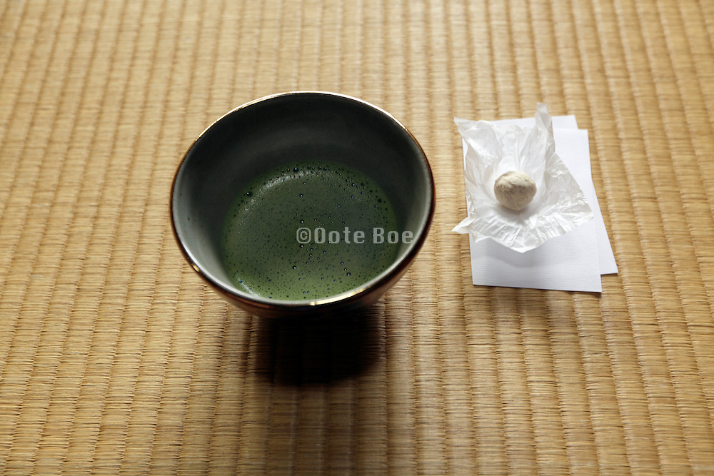 green matcha tea with sweet on tatami floor