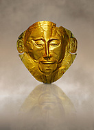 """Gold Death Mask Known as the """"mask of Agamemnon""""  from Grave V, Grave Circle A, Mycenae. The mask is made of a thin sheet of beaten gold & shows a man with a beard. 16th century BC. Cat No 624 Athens Archaeological Museum."""
