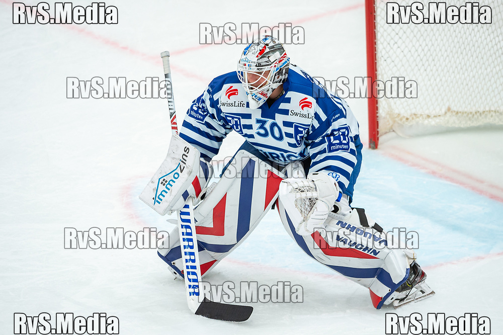 LAUSANNE, SWITZERLAND - OCTOBER 01: Goalie Lukas Flueler #30 of ZSC Lions warms up prior the Swiss National League game between Lausanne HC and ZSC Lions at Vaudoise Arena on October 1, 2021 in Lausanne, Switzerland. (Photo by Robert Hradil/RvS.Media)