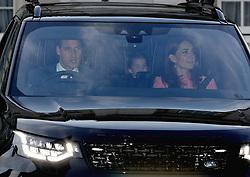 The Duke of Cambridge, Princess Charlotte and the Duchess of Cambridge leaving the Queen's Christmas lunch at Buckingham Palace, London.