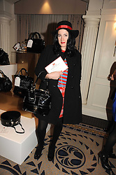 AMY MOLYNEAUX at the In Style Handbag Auction is association with Revlon raising money for the Rainbow Trust children's charity held at the Berkeley Hotel, Knightsbridge, London on 4th November 2008.