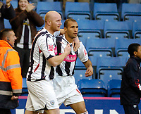 Photo: Leigh Quinnell.<br /> West Bromwich Albion v Coventry City. Coca Cola Championship. 16/12/2006. West Broms John Hartson congratulates Diomansy Kamara(R) on his goal after forty seconds.