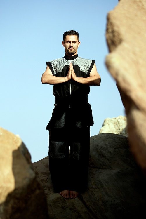 ACTON, CALIFORNIA, March 25, 2007: Shervin Ilbeig stands on rocks and prays at Vazquez Rocks in Acton, California. (Photograph by Todd Bigelow/Aurora)