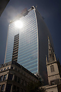 The intensive glare of solar rays reflected off the concave plate glass windows of one of the capital's newest skyscrapers known as the Walkie Talkie. The hotspot has surprised developers and passers-by below and which has already melted a parked car in Eastcheap Street. Thermometers placed in the street reached 144F (62 celsius) and city workers poured out of their offices at lunchtime to experience the intense light and heat.