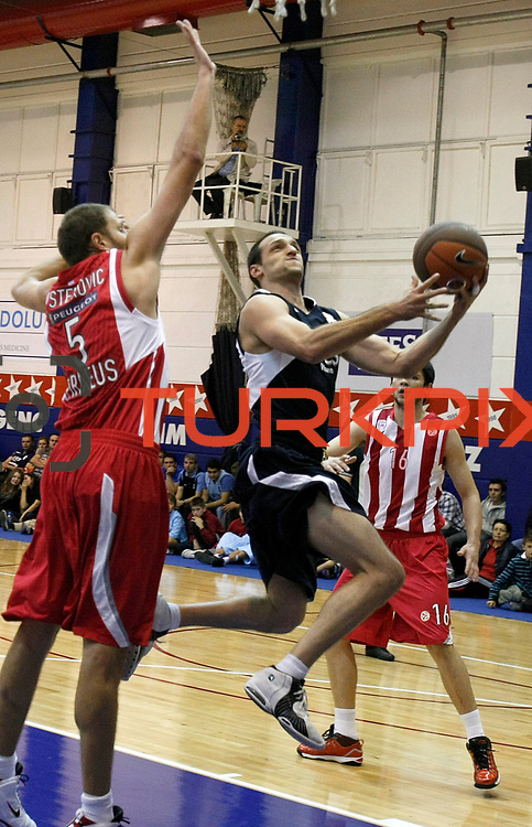 Efes Pilsen's Igor RAKOCEVIC (C) during their friendly basketball match Efes Pilsen between Olympiacos at Efes Pilsen Arena in Istanbul, Turkey, Sunday, October 03, 2010. Photo by TURKPIX