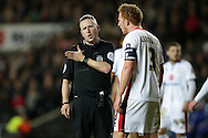 Referee Jonathan Moss talking to Dean Lewington of MK Dons after he awards Chelsea a penalty. The Emirates FA cup, 4th round match, MK Dons v Chelsea at the Stadium MK in Milton Keynes on Sunday 31st January 2016.<br /> pic by John Patrick Fletcher, Andrew Orchard sports photography.