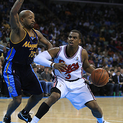 28 January 2009:  New Orleans Hornets guard Chris Paul (3) defended by Denver Nuggets guard Anthony Carter (25) during a 94-81 win by the New Orleans Hornets over the Denver Nuggets at the New Orleans Arena in New Orleans, LA. The Hornets wore special throwback uniforms of the former ABA franchise the New Orleans Buccaneers for the game as they honored the Bucs franchise as a part of the NBA's Hardwood Classics series. .