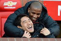 Manchester United's Shinji Kagawa and Ashley Young (top) on the bench