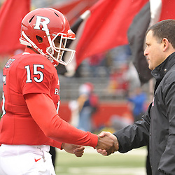 Dec 5, 2009; Piscataway, NJ, USA; Rutgers head coach Greg Schiano shakes hands with quarterback Jabu Lovelace during the senior ceremony before first half NCAA Big East college football action between Rutgers and West Virginia at Rutgers Stadium.