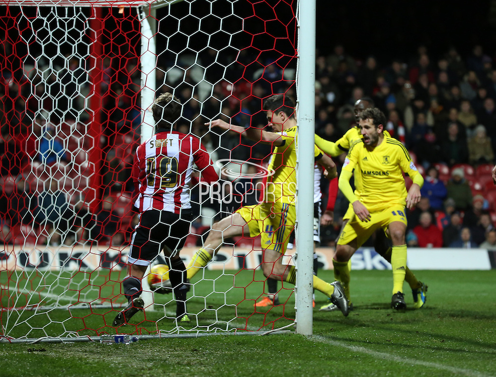 Middlesbrough defender Daniel Ayala scoring Middlesbrough 1st goal to make it 1-0 during the Sky Bet Championship match between Brentford and Middlesbrough at Griffin Park, London, England on 12 January 2016. Photo by Matthew Redman.