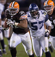 Cleveland's Jamal Lewis, left, runs for 34 yards after a short pass in overtime  Sunday, Nov. 4, 2007 against Seattle.