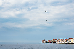 After two months of restoration, the Statue of Archangel Michael, made of copper plate, returned to Piran. The image shows helicopter placing it on top of the church's clock, on October 15, 2018 in Piran, Slovenia. Photo by Matic Klansek Velej / Sportida