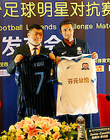 Argentine football star Javier Zanetti, right, and a Chinese official exchange jerseys at a press conference for the 2014 China-Italy The Football Legends Challenge Match in Wuhan city, central China's Hubei province, 16 October 2014.<br /> <br /> The 2014 China-Italy The Football Legends Challenge Match will kick off on Sunday (19 October 2014) in the central Chinese city of Wuhan.