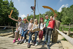 Group of children playing on a pirate ship in adventure playground, Bavaria, Germany